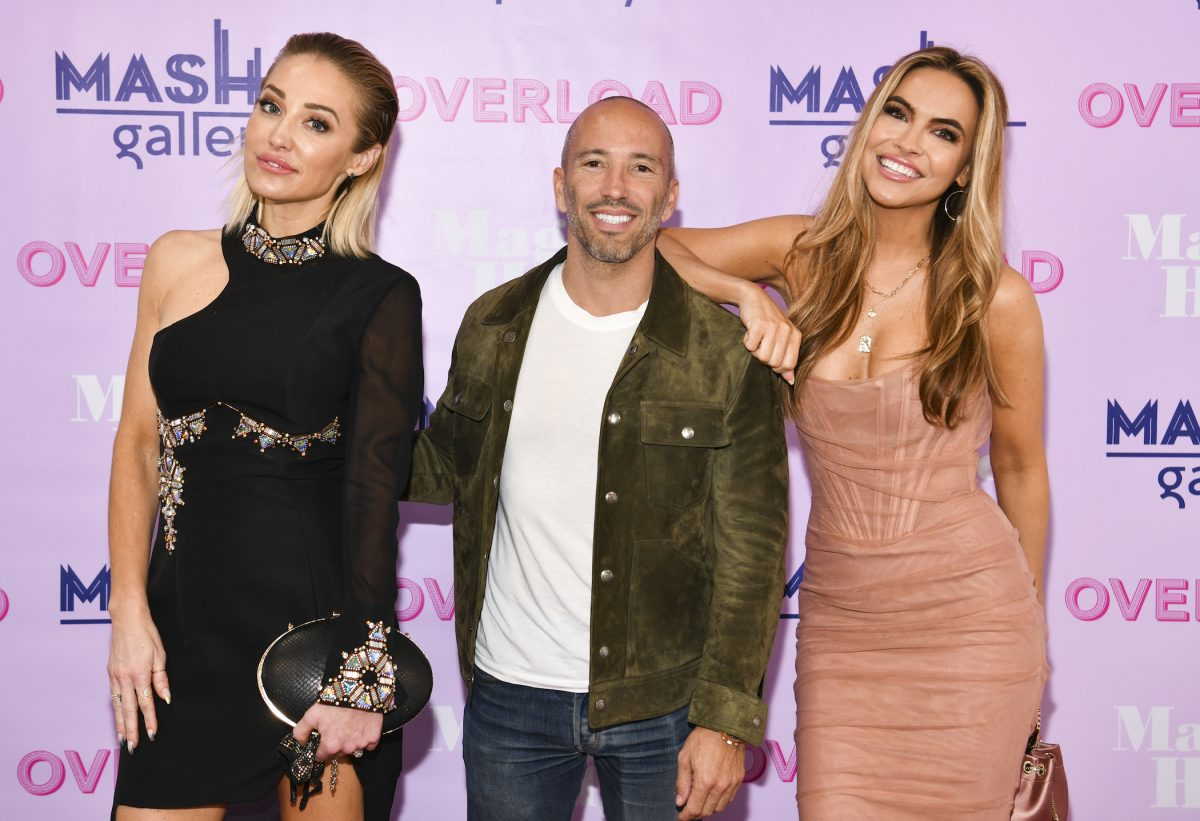(L-R) Mary Fitzgerald, Jason Oppenheim, and Chrishell Stause from 'Selling Sunset' Season 4 standing together at an event