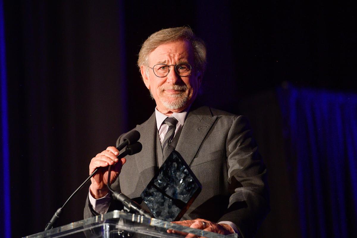 Steven Spielberg wears a suit and speaks onstage