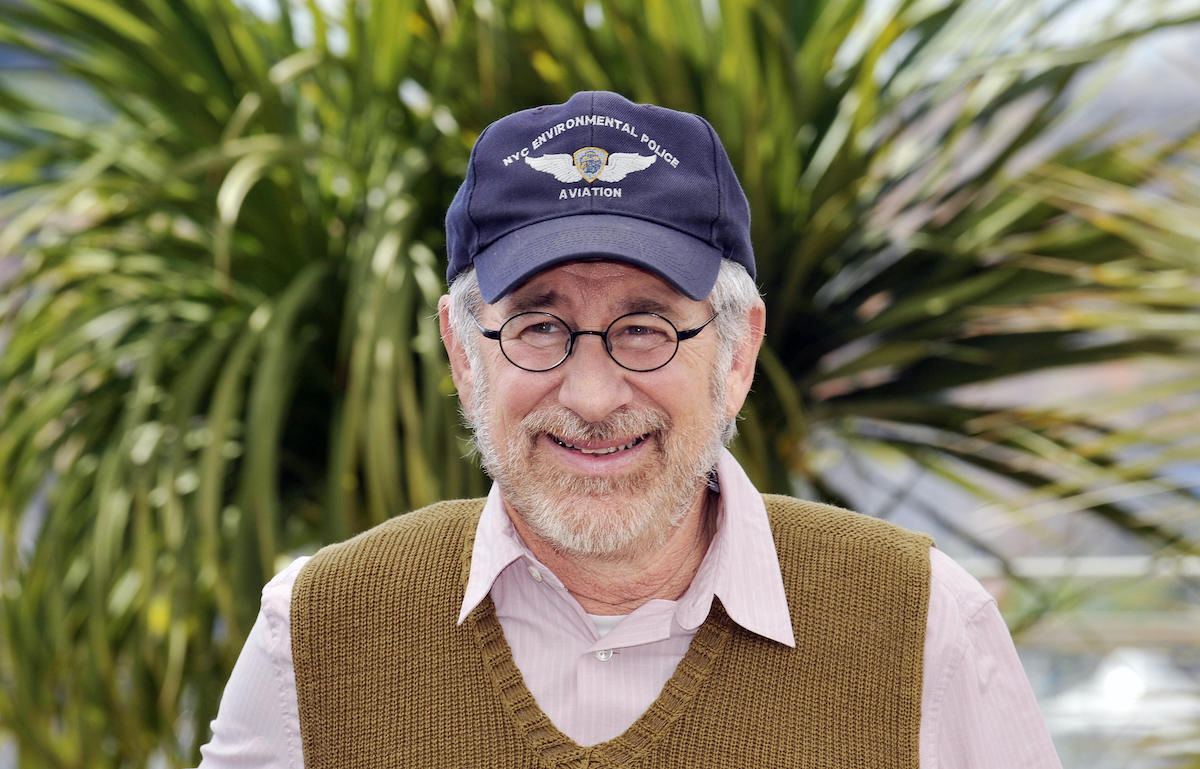 Steven Spielberg wears a hat and smiles