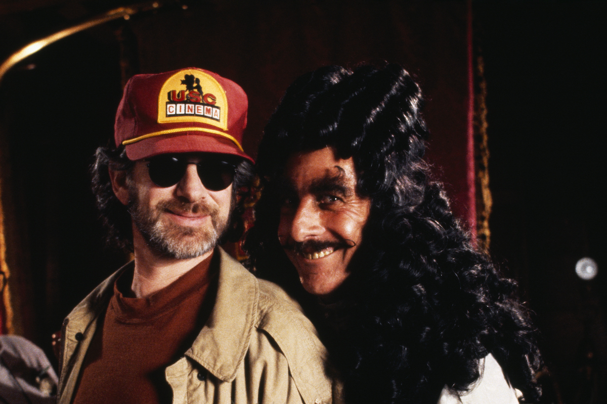 Steven Spielberg smiles in sunglasses and Dustin Hoffman in costume on the set of 'Hook'
