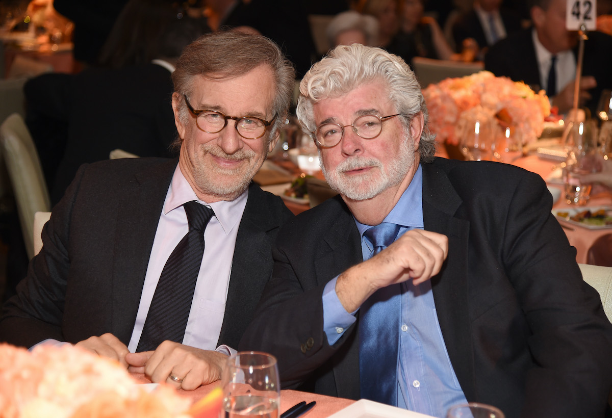Steven Spielberg and George Lucas wear suits and pose