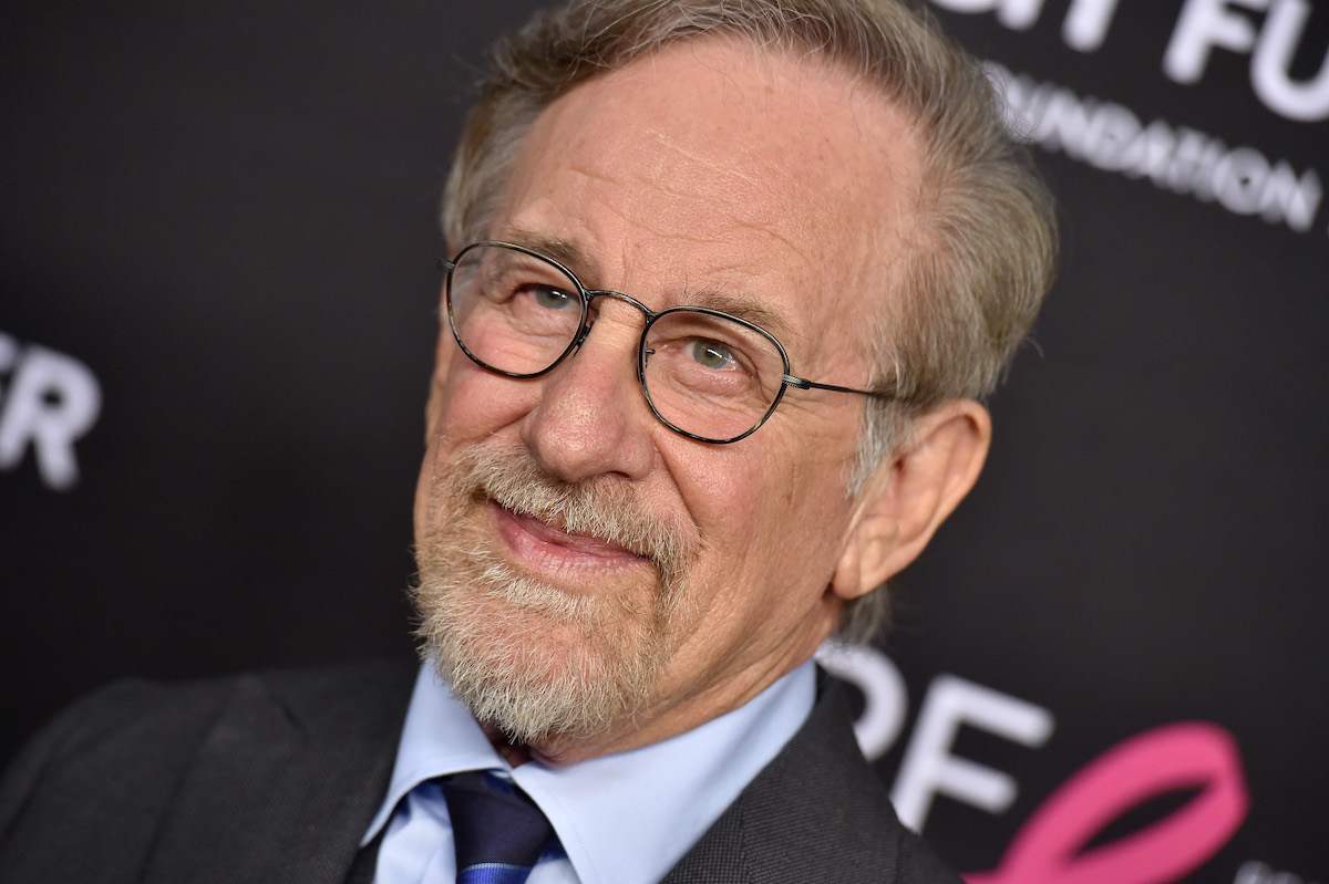 Steven Spielberg wears a suit and smiles