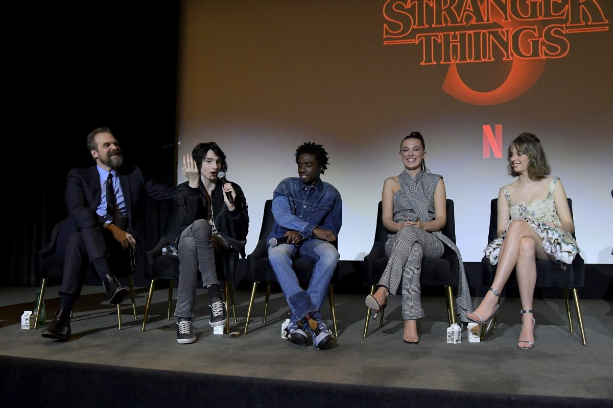 David Harbour, Finn Wolfhard, Caleb McLaughlin, Millie Bobby Brown, and Maya Hawke speak on stage during Netflix's 'Stranger Things' Q&A