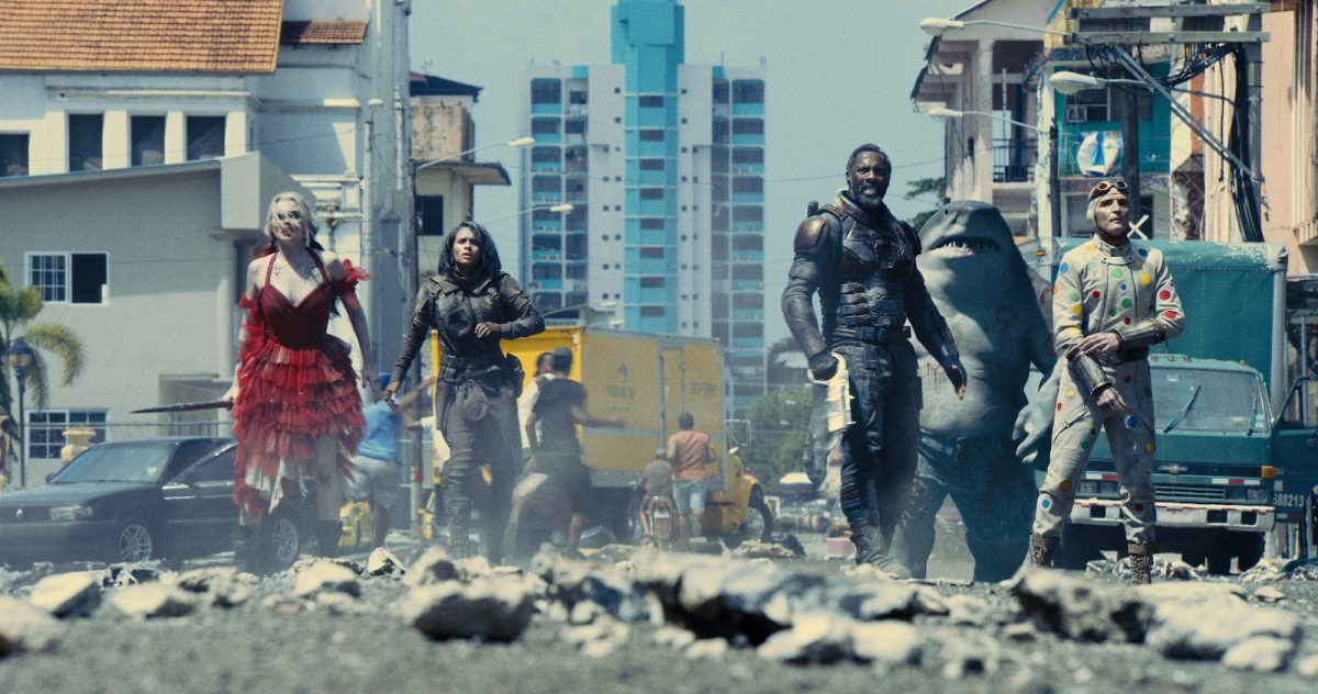 Suicide Squad stands in the crumbled street