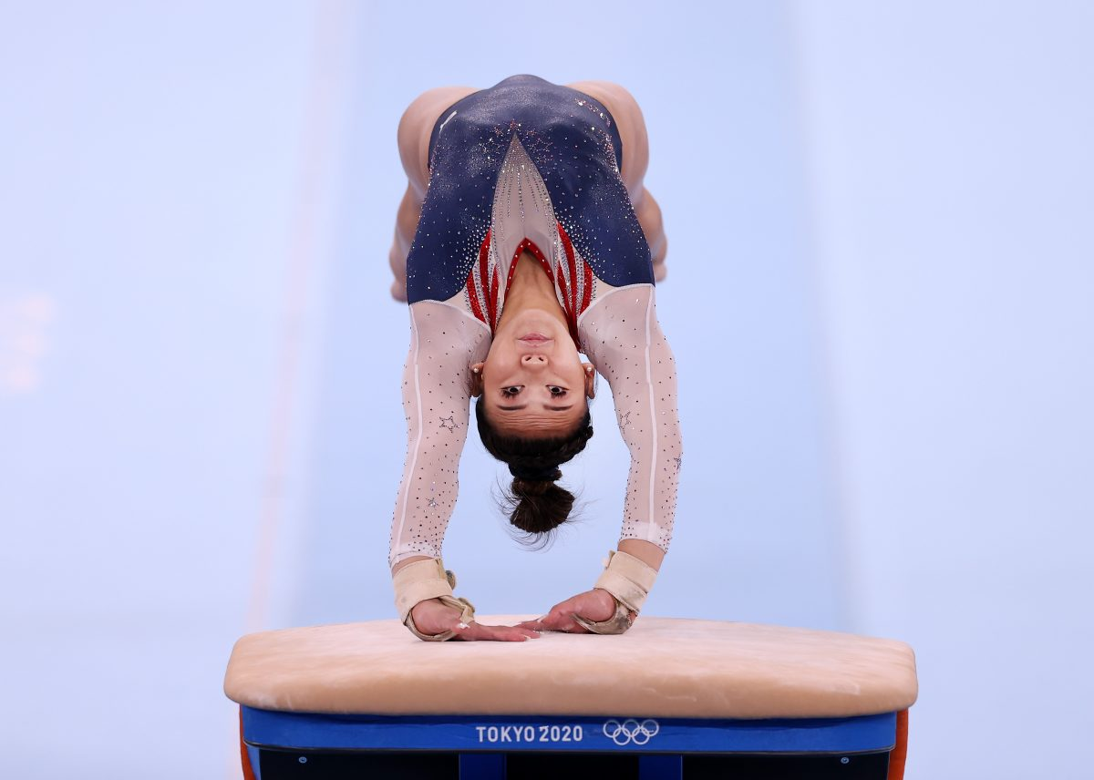 Suni Lee competing on vault during the Women's All-Around Final