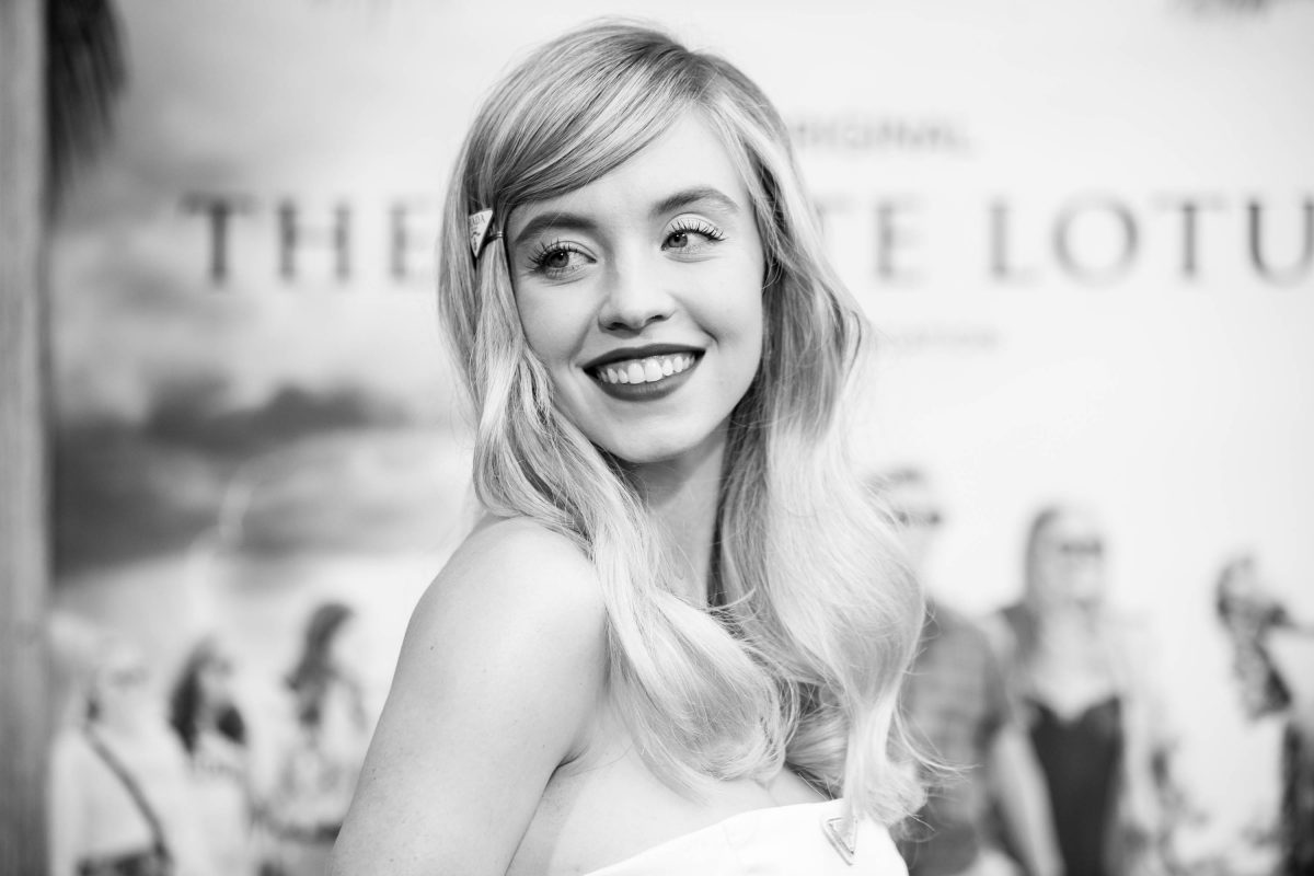 The White Lotus cast member Sydney Sweeney wears a white dress to the premiere of the show