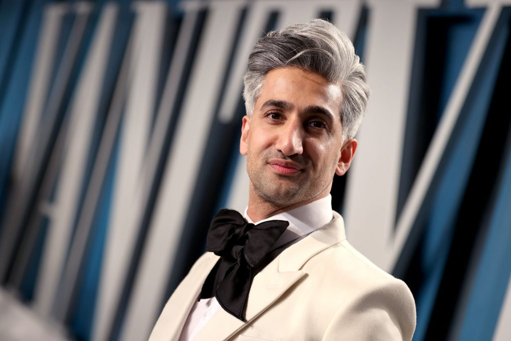 Tan France in a white suit at a Vanity Fair Oscar Party