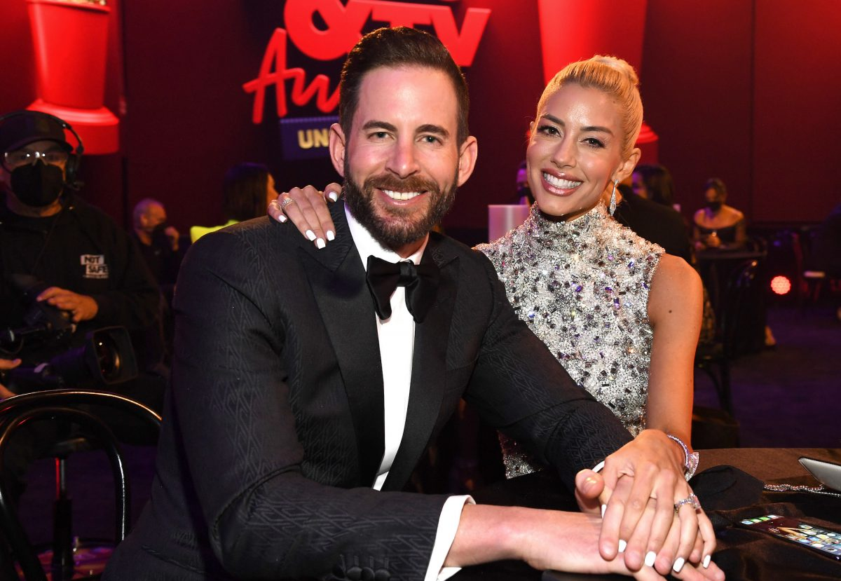 Heather Rae Young of 'Selling Sunset' Season 4 with her arm around Tarek El Moussa at the MTV Movie and TV Awards