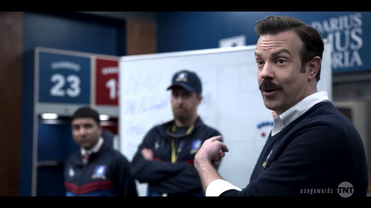 Jason Sudeikis as Ted Lasso character, Brendan Hunt as Coach Beard, and Nick Mohammed as Nathan Shelley