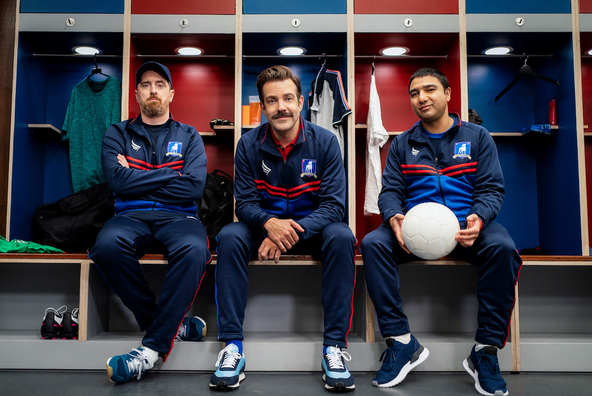 (L-R) Brendan Hunt, Jason Sudeikis, and Nick Mohammed in 'Ted Lasso' Season 2