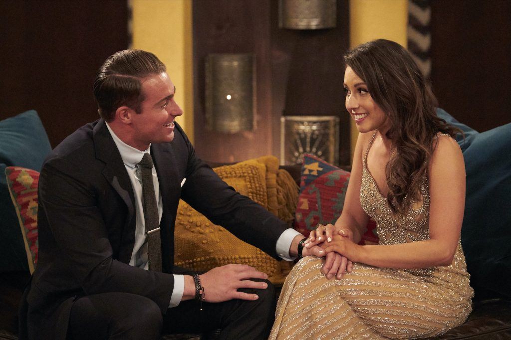 James and Katie Thurston seated, making more 'The Bachelorette' trivia to learn