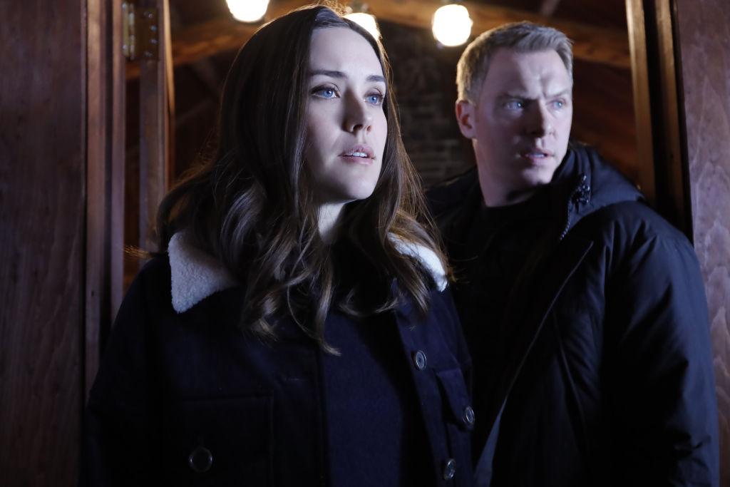 Megan Boone as Elizabeth Keen, Diego Klattenhoff as Donald Ressler look out for danger.