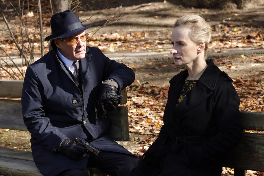 James Spader as Raymond 'Red' Reddington sits next to Laila Robins as Katarina Rostova on a park bench.