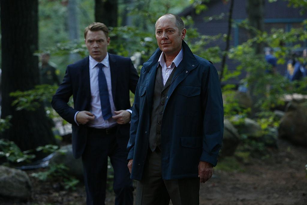 Diego Klattenhoff as Donald Ressler, James Spader as Raymond 'Red' Reddington stand in the woods overlooking a crime scene.