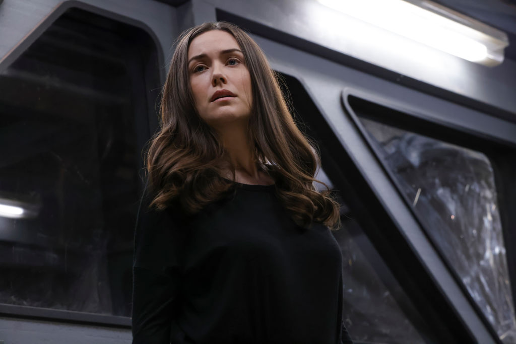 Megan Boone as Liz Keen looks out from the box they've placed her in after her arrest.