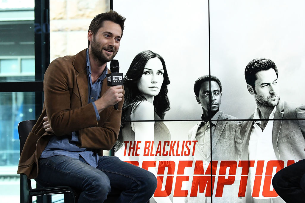 Ryan Eggold sits in a chair to discuss 'The Blacklist: Redemption'.