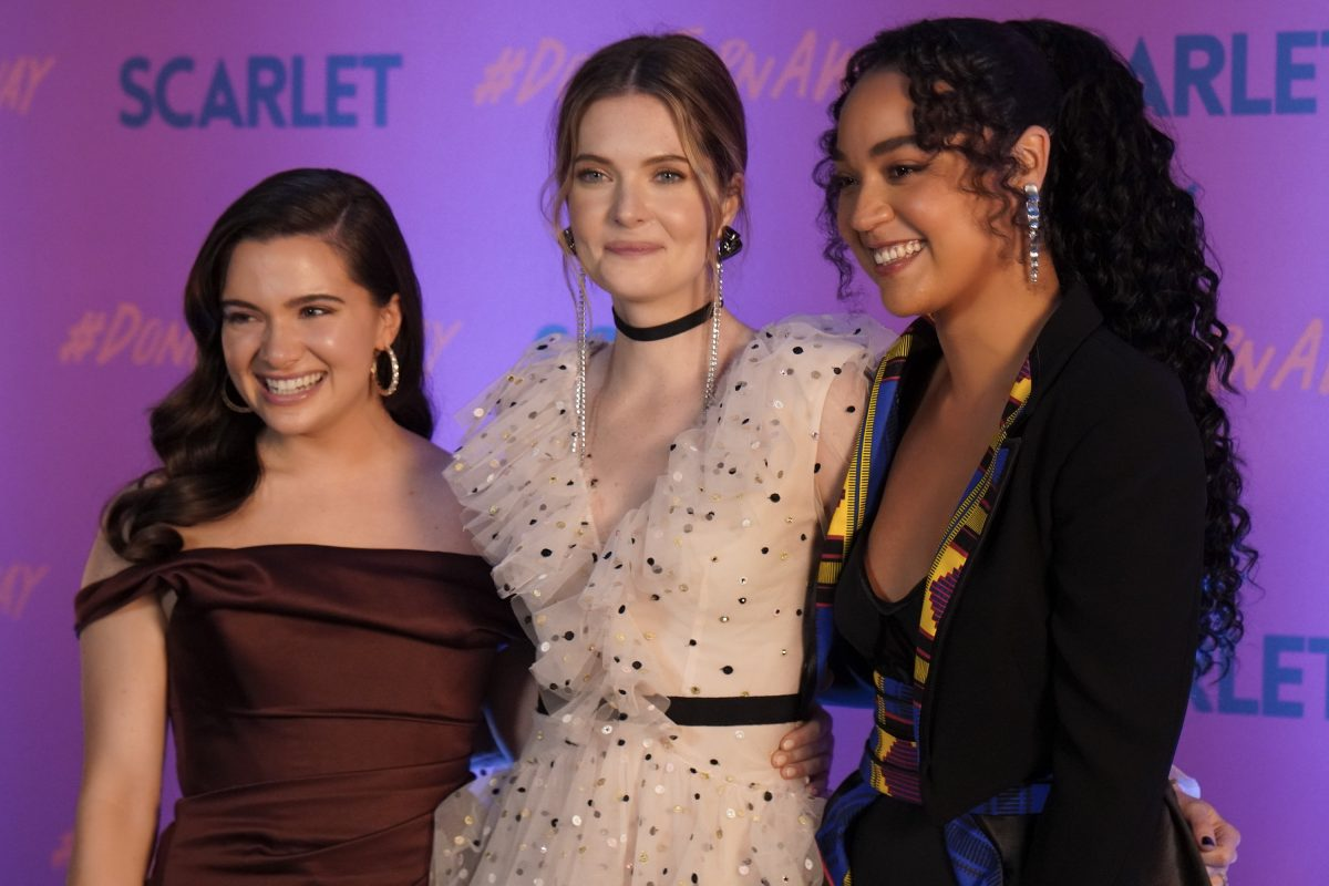 Jane, Sutton, and Kat smile in front of a backdrop for Scarlet Magazine in 'The Bold Type'