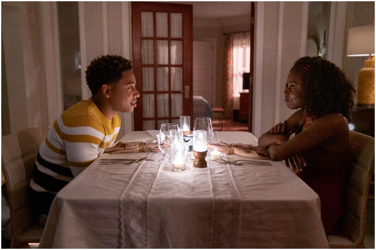 'The Chi' actors Jacob Latimore and Birgundi Baker as Emmett and Kiesha smiling at dinner.