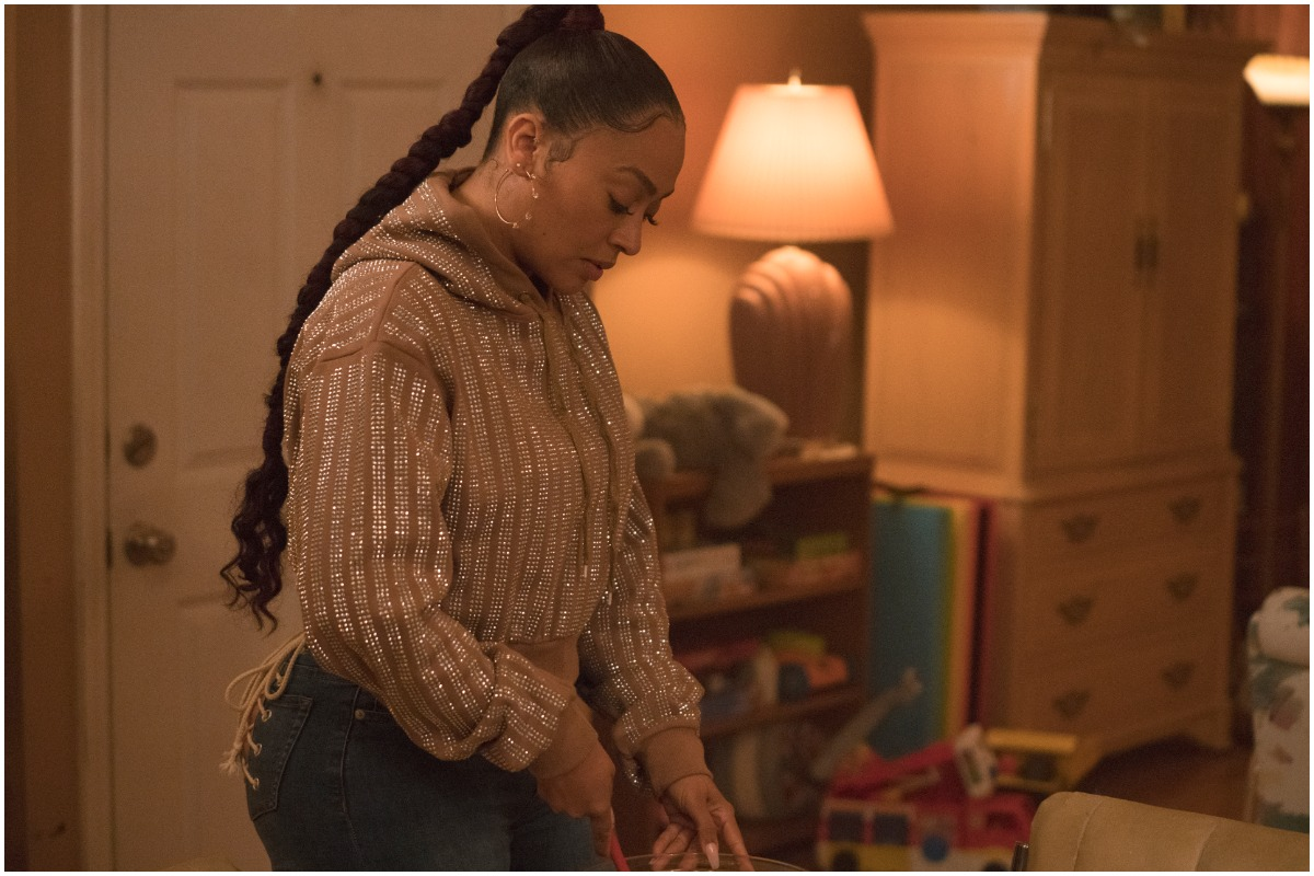 'The Chi' and 'Power' actor La La Anthony looking down while wearing a sweater and jeans.