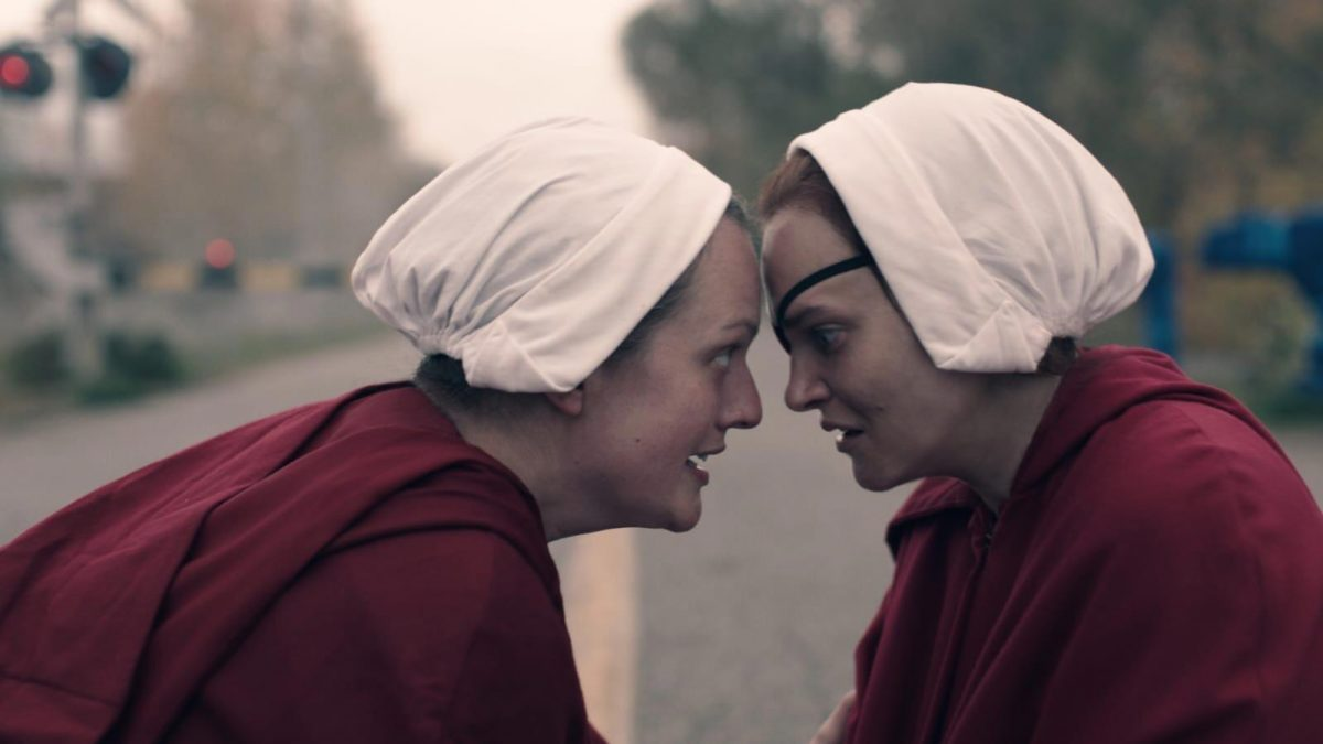 June and Janine touch foreheads in front of train tracks in 'The Handmaid's Tale'
