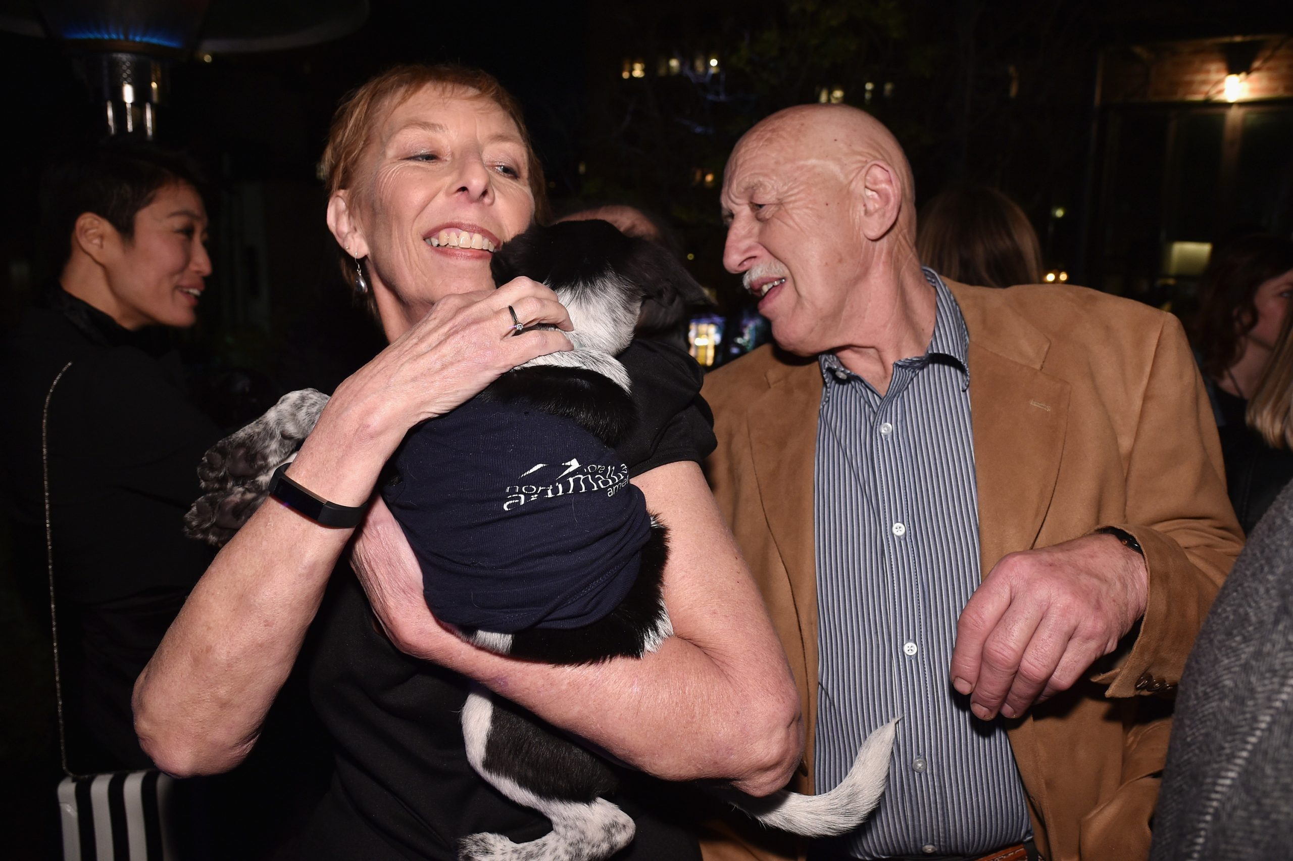 Diane Pol and Dr. Jan Pol of 'The Incredible Dr. Pol' with a furry friend