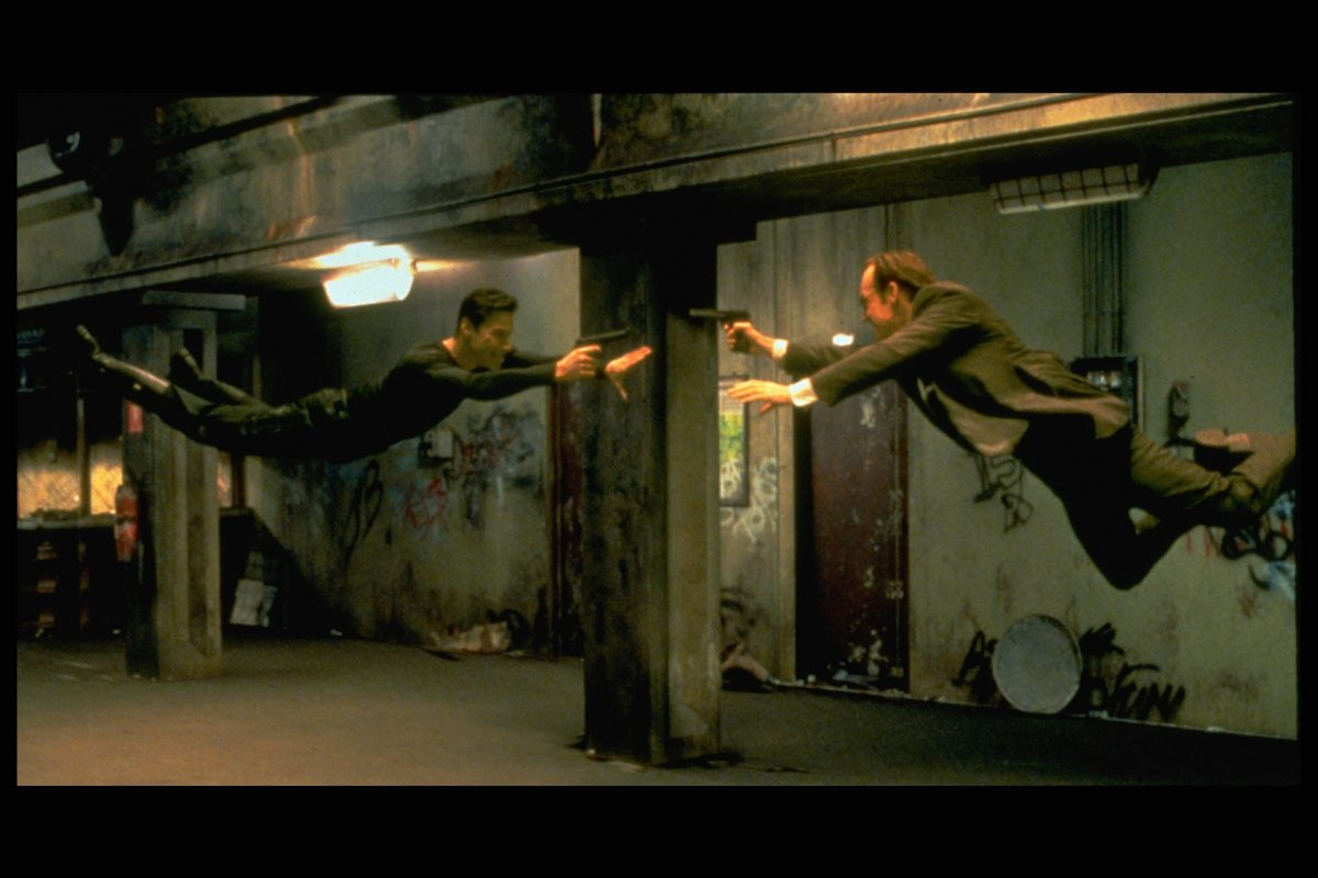 The Matrix: Keanu Reeves and Hugo Weaving shoot at each other