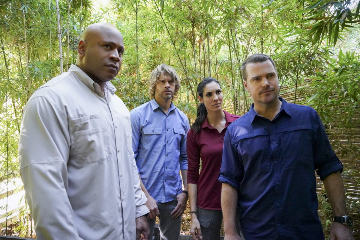 Actors LL Cool J, Eric Christian Olsen, Daniela Ruah, and Chris O'Donnell stand outside in a scene from 'NCIS: Los Angeles.'