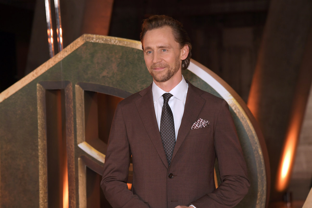 'Loki' star Tom Hiddleston wears a suit and smiles