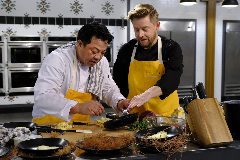 Top Chef Amateurs home cook Lorenzo Beronilla works with Top Chef rock star Richard Blais