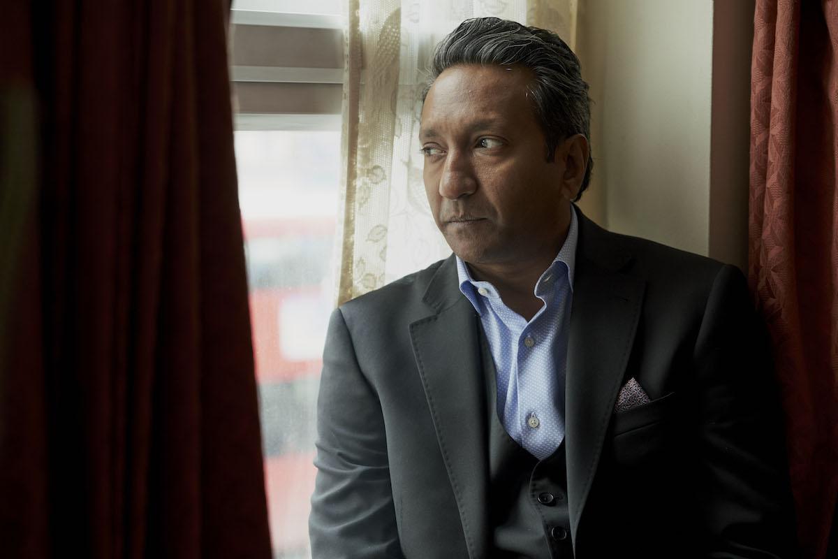 Ram looking out a window in 'Unforgotten'