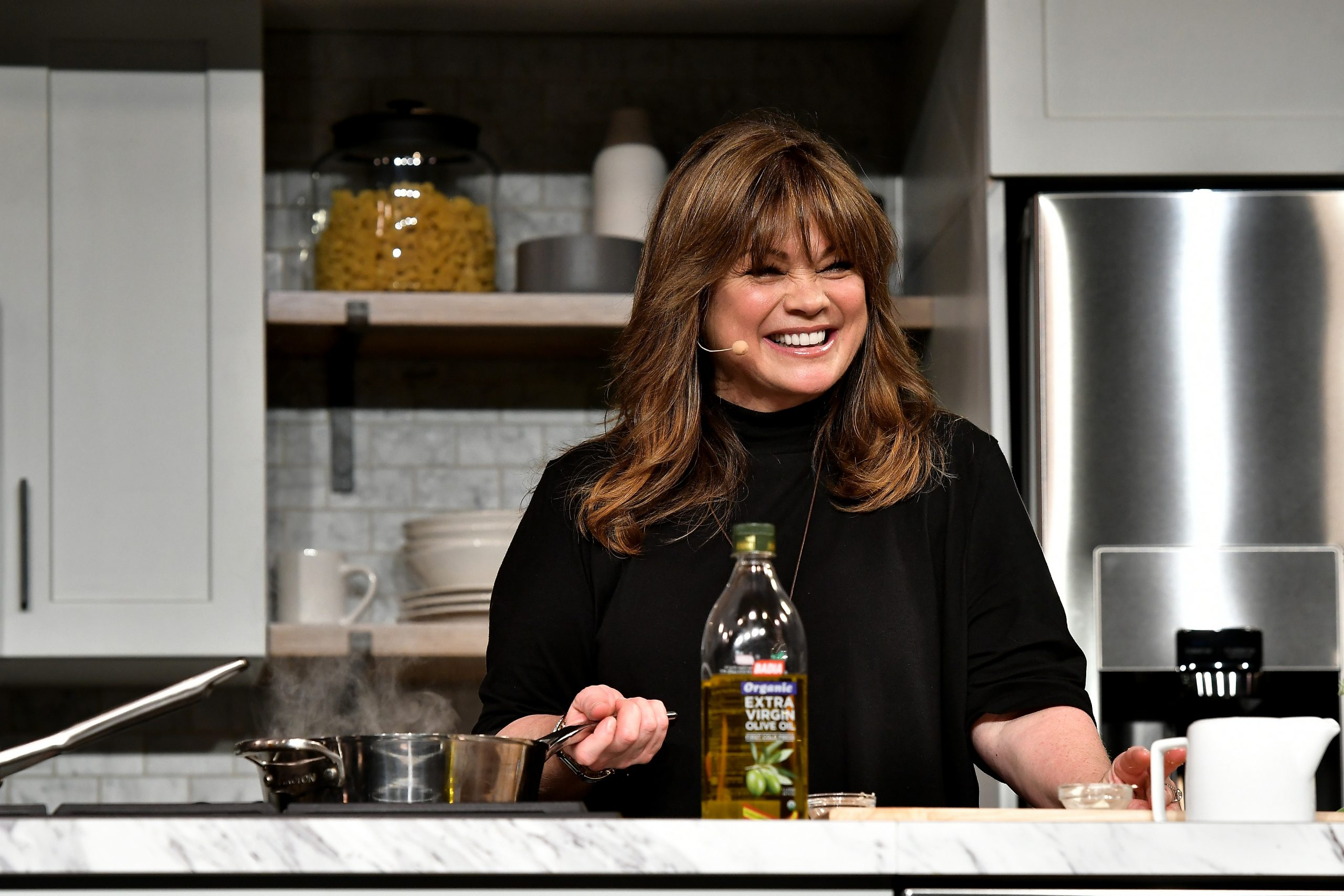 Food Network personality Valerie Bertinelli prepares a meal at a network-hosted event in 2017.