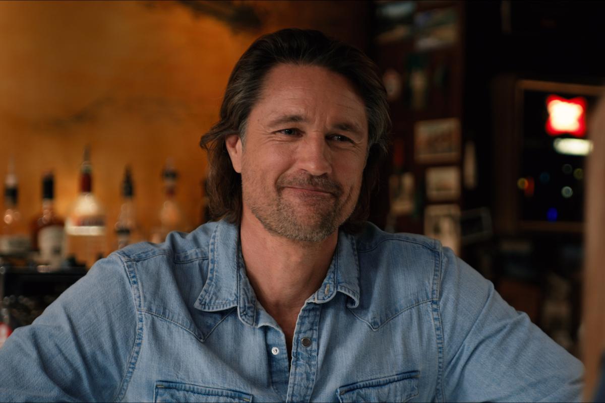 Smiling Jack (Martin Henderson) wearing a blue shirt in 'Virgin River' Season 3