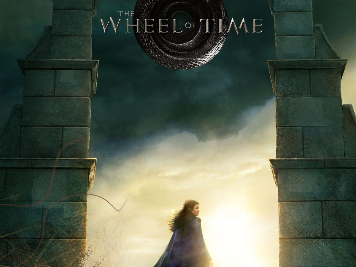 Poster for Amazon's Wheel of Time series shows Rosamund Pike's Moiraine standing in an archway