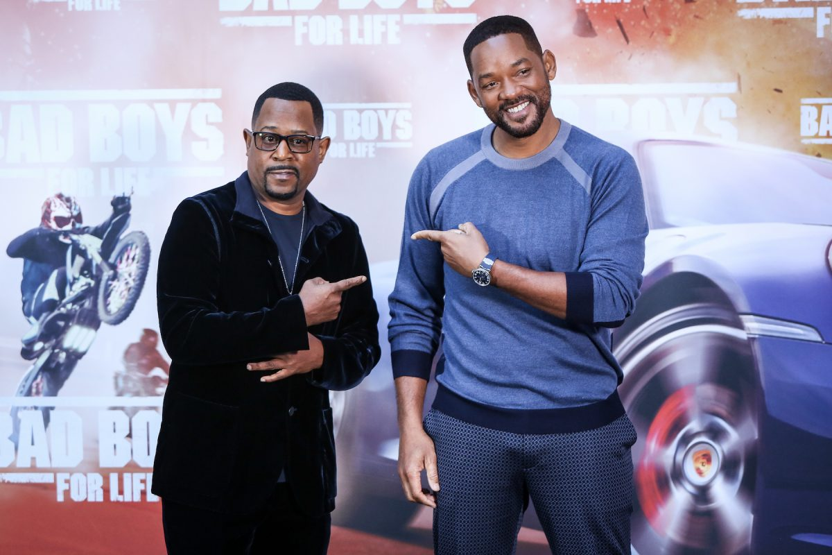 Martin Lawrence and Will Smith smiling and standing side by side as they attend the 'Bad Boys For Life' photo call in 2020