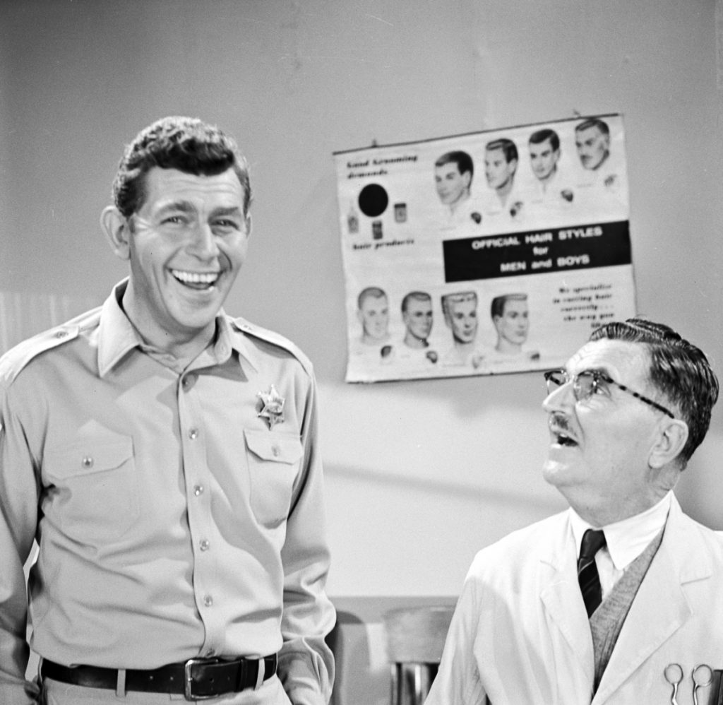 Andy Griffith, left, laughs with 'Floyd the barber' actor Howard McNear in a scene from 'The Andy Griffith Show'