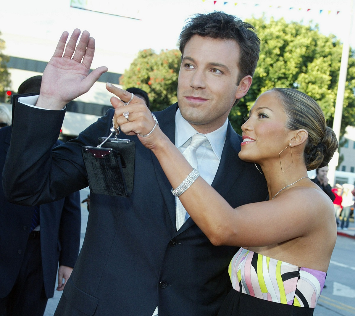 Jennifer Lopez (R) shows off her engagement ring with fiance Ben Affleck at the 'Daredevil' premiere in 2003.