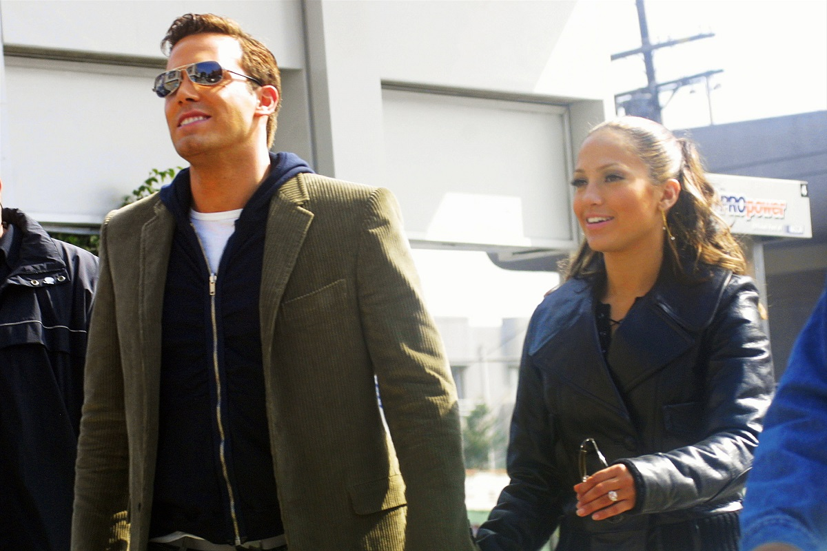 Jennifer Lopez and Ben Affleck (R) hold hands while filming her 'Jenny From the Block' music video on October 20, 2002, in Beverly Hills, California.