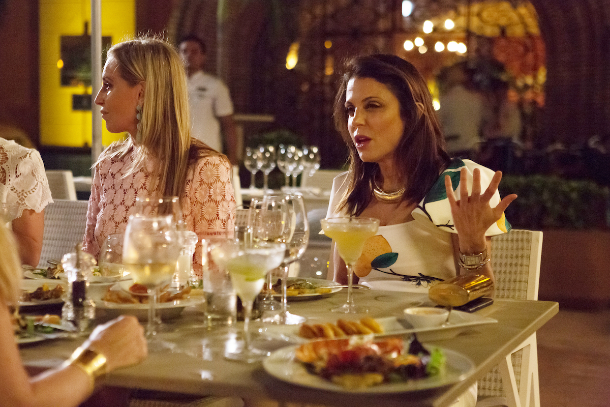 Bethenny Frankel in a 'RHONY' Season 10 scene sitting at a table and looking confused