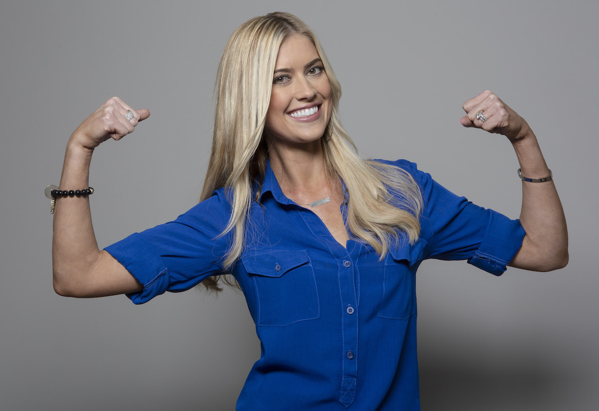 Christina Haack flexing her biceps in a 'Flip or Flop' photo session from 2017