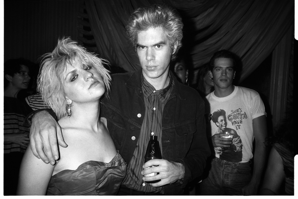 Black and white photo of Courtney Love and Jim Jarmusch at a party for 'Sid & Nancy'