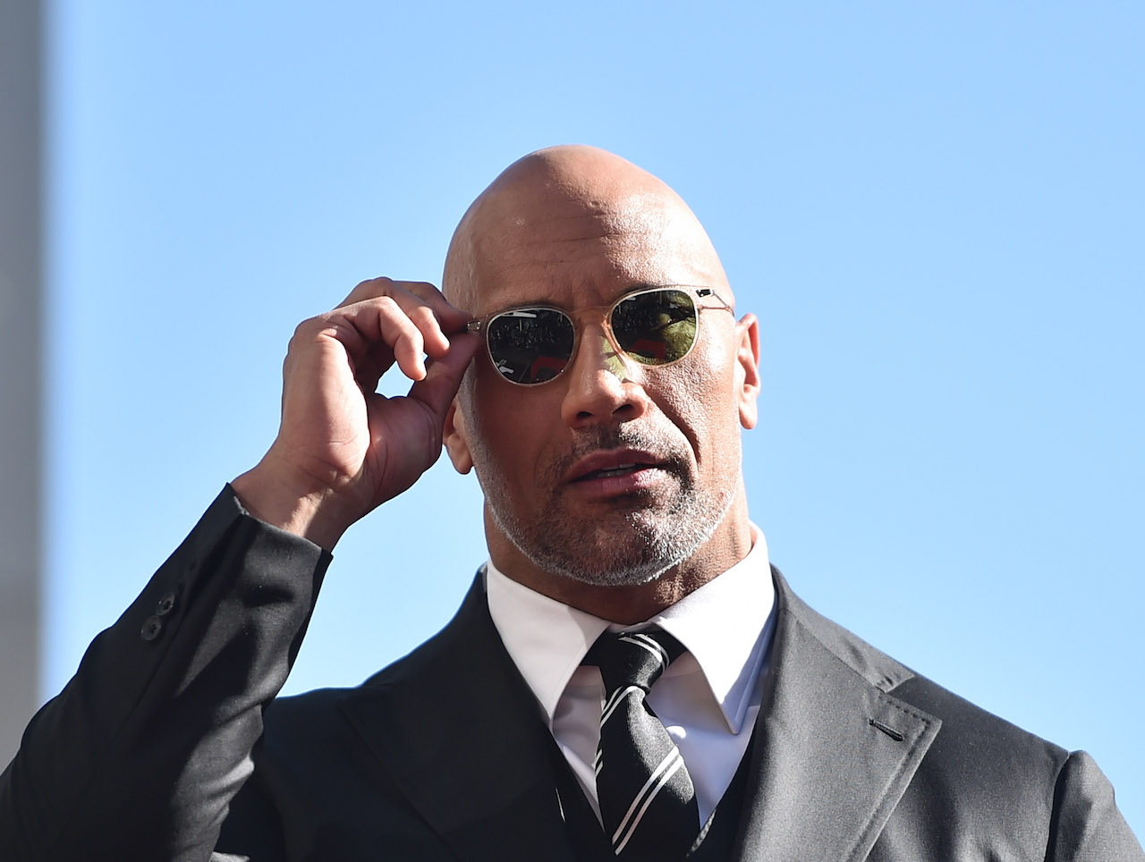 Dwayne Johnson attends a ceremony honoring him with the 2,624th star on the Hollywood Walk of Fame