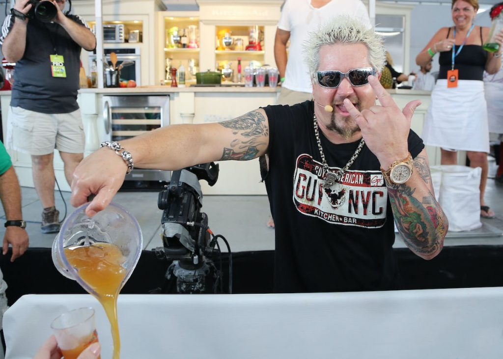 Guy Fieri poses for the camera in 2013