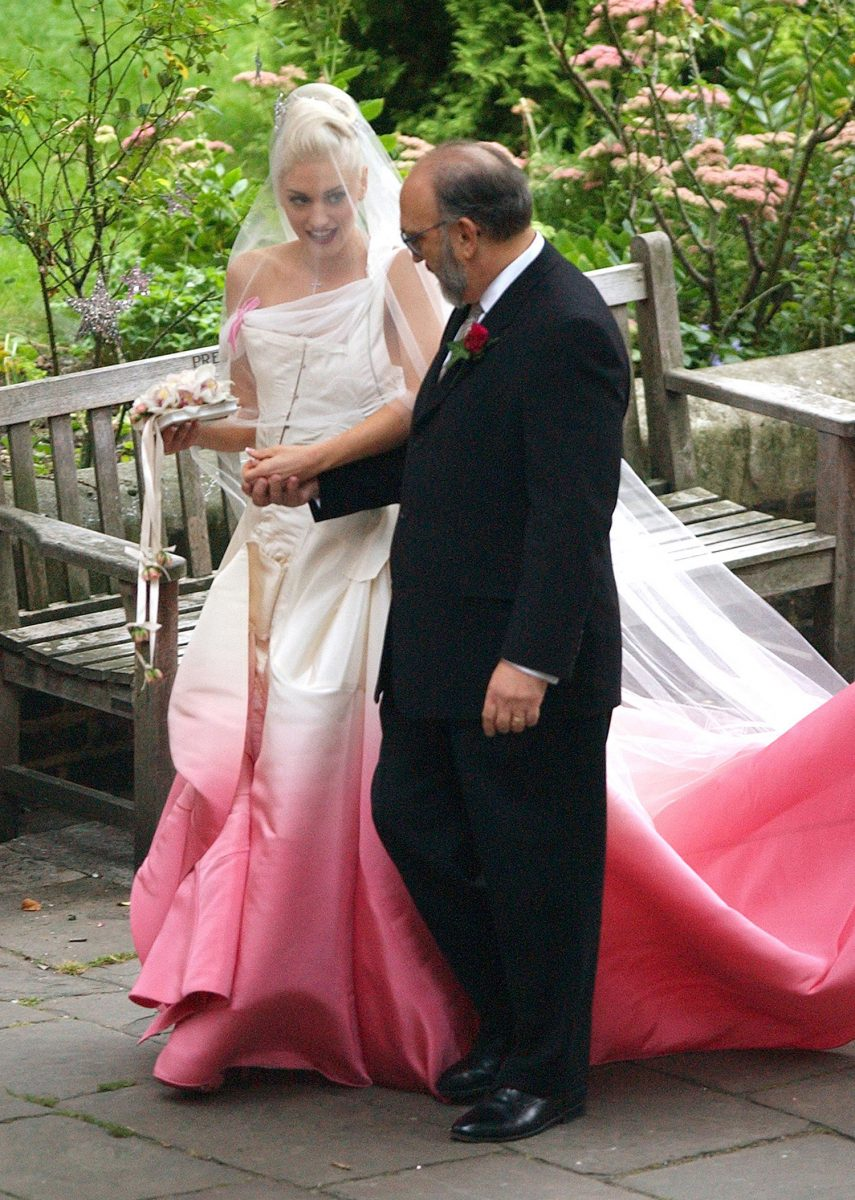 Gwen Stefani holds hands with her father during her wedding ceremony with Gavin Rossdale in 2002..