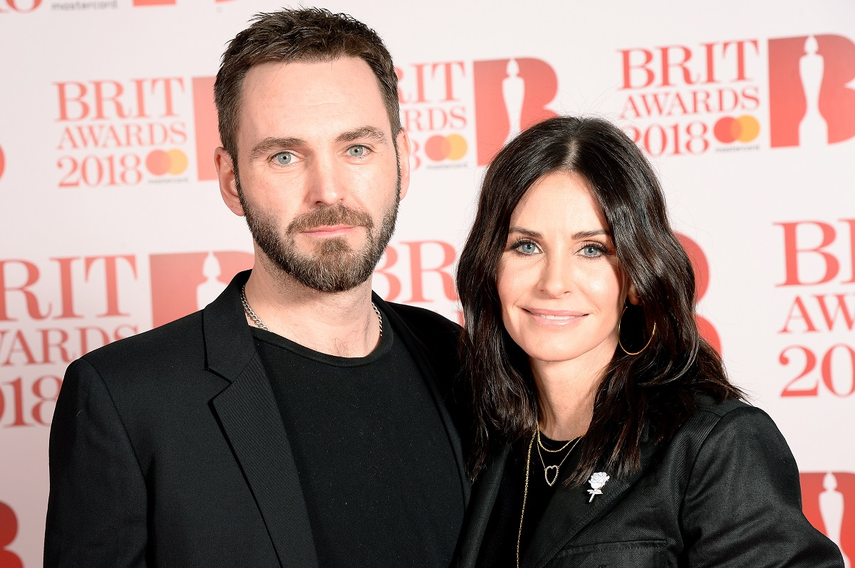 Johnny McDaid (L) and Courteney Cox attend The BRIT Awards 2018 on February 21, 2018, in London, England.