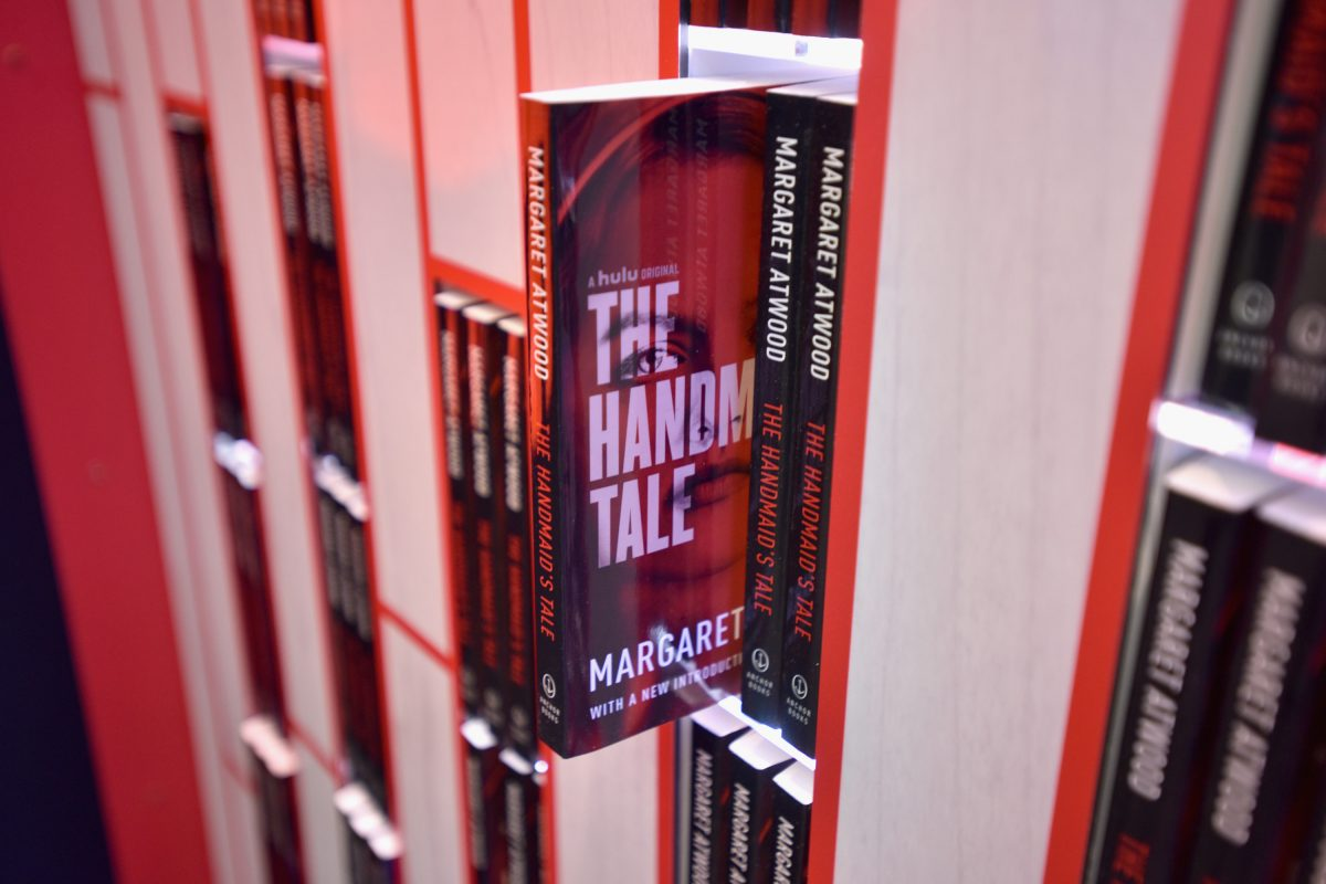 Copies of Margaret Atwood's book 'The Handmaid's Tale' sticking on shelves