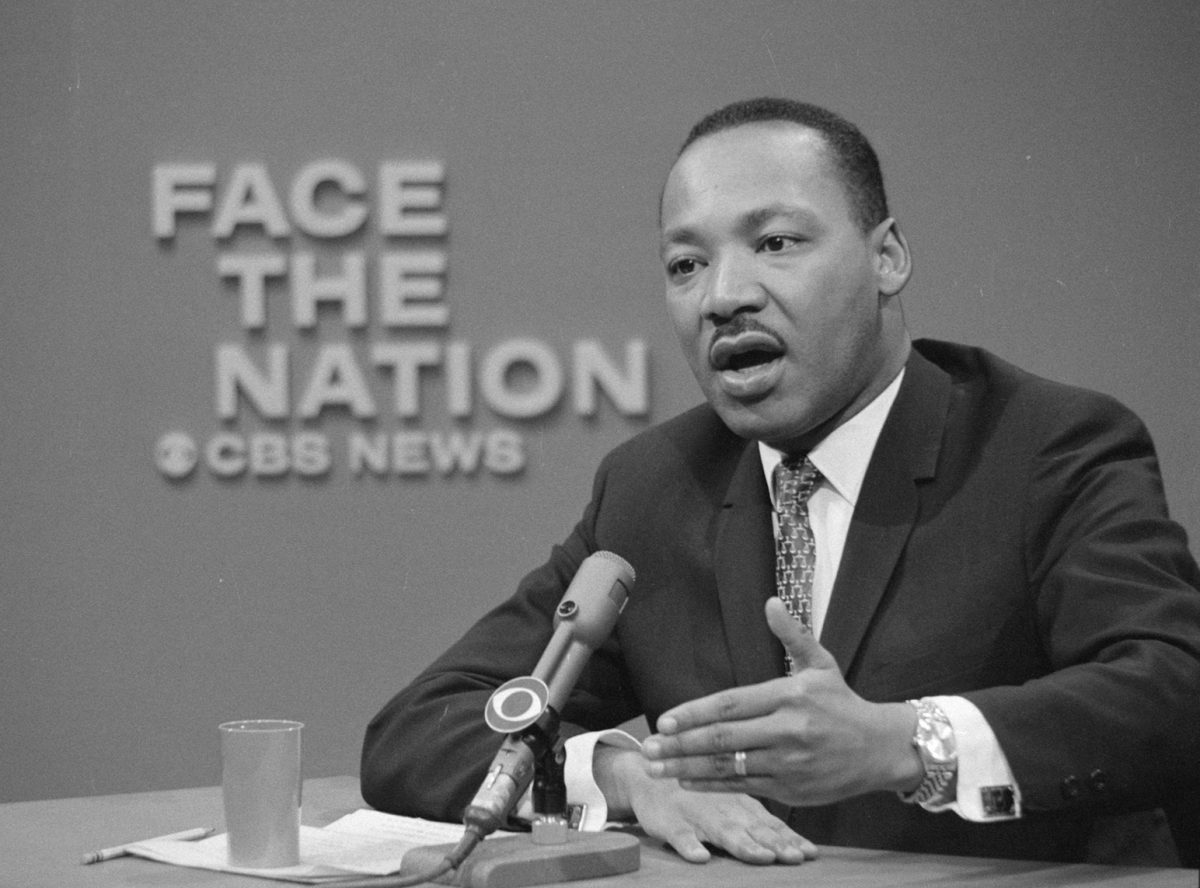 Dr. Martin Luther King at a desk