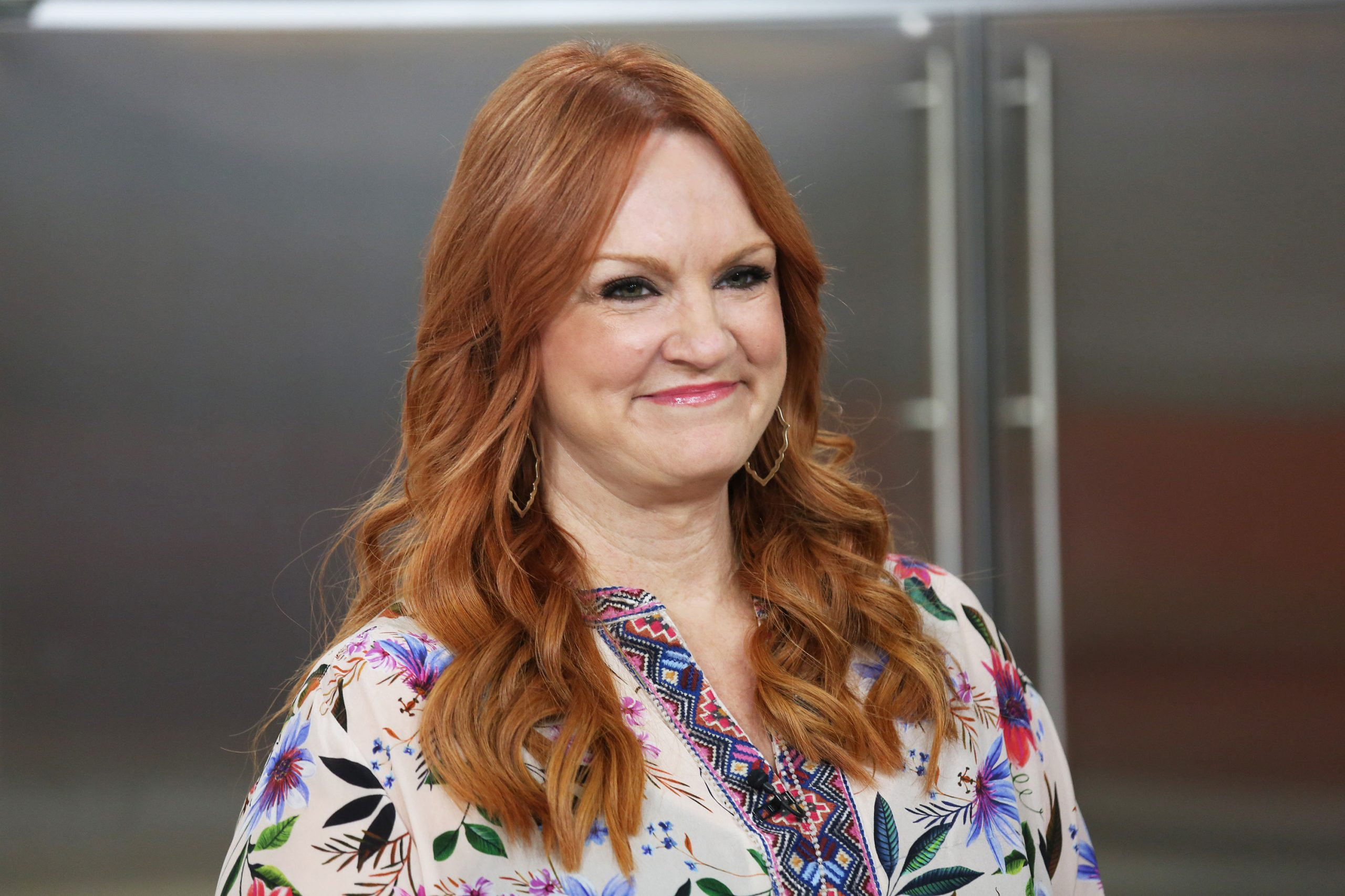 'The Pioneer Woman' Ree Drummond smiles at the camera. She wears a multi-color print top.
