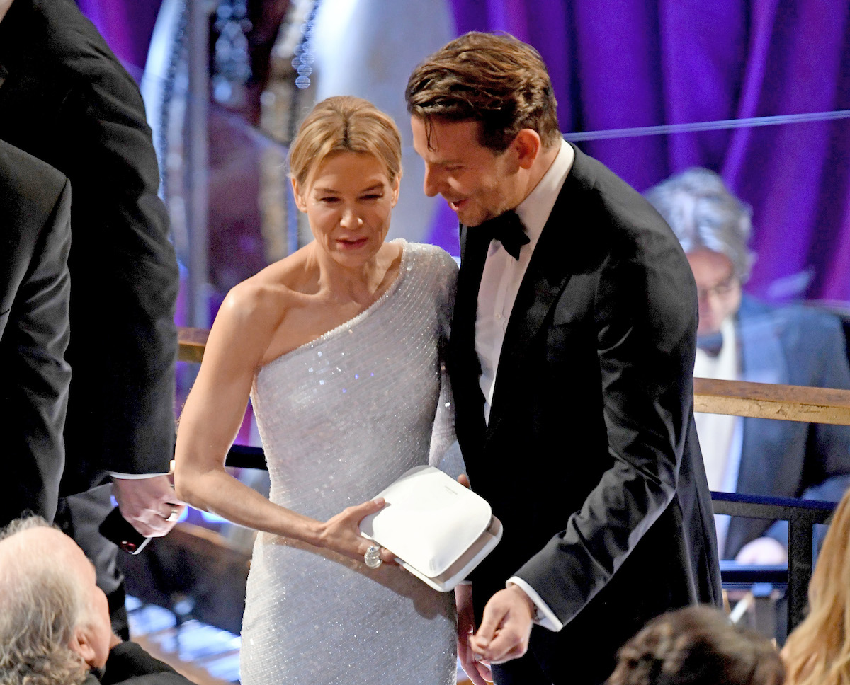 Bradley Cooper leans in to talk to Renee Zellweger at the 2020 Academy Awards