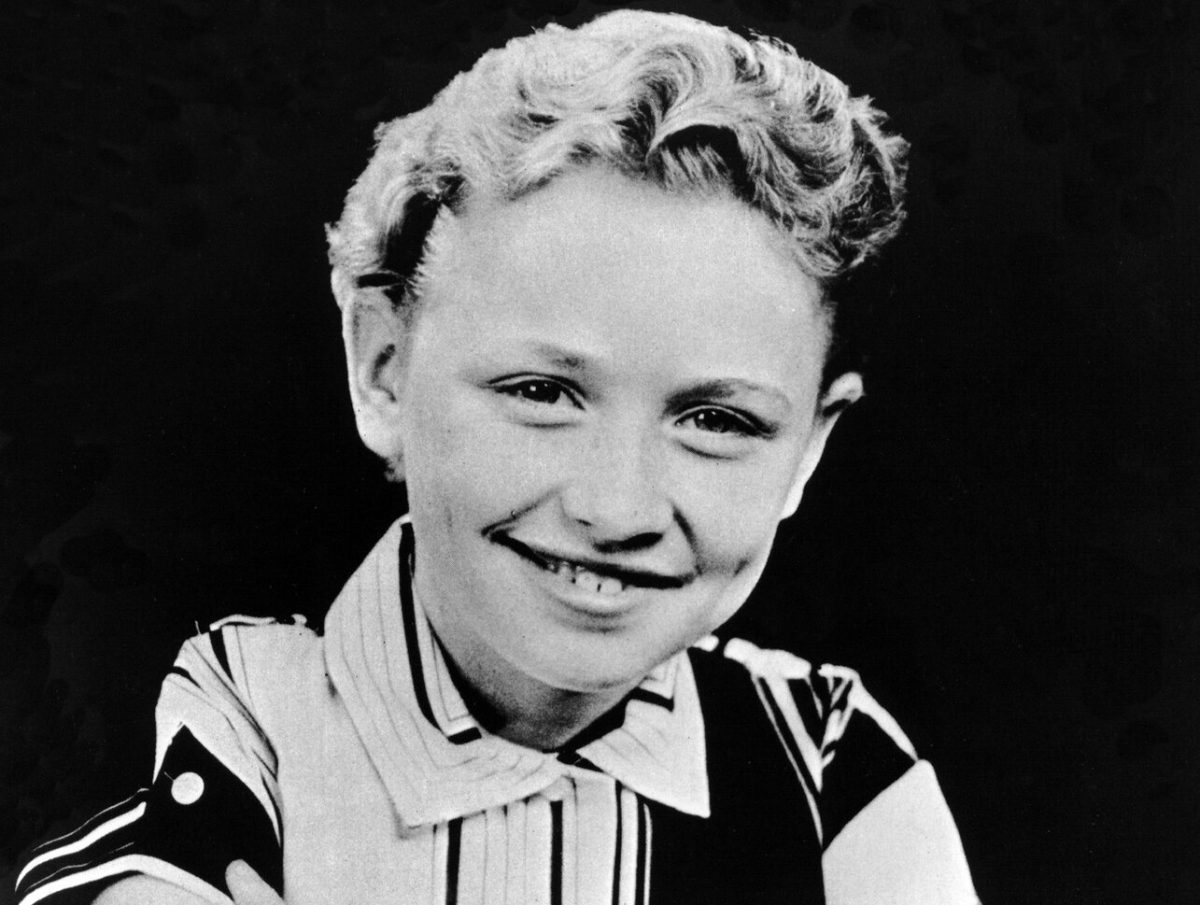 Dolly Parton as a child, photographed in black and white in 1955.
