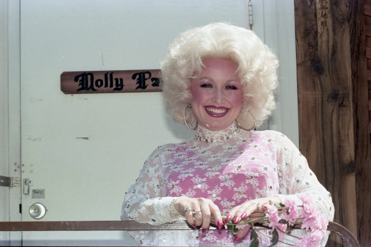 Dolly Parton poses for a portrait backstage at Day on the Green concert at Oakland Coliseum on May 28, 1978 in Oakland, California.